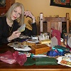 Janax with her tarot cards and tools.