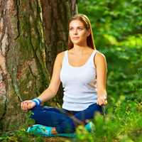 Woman Meditating in Woods